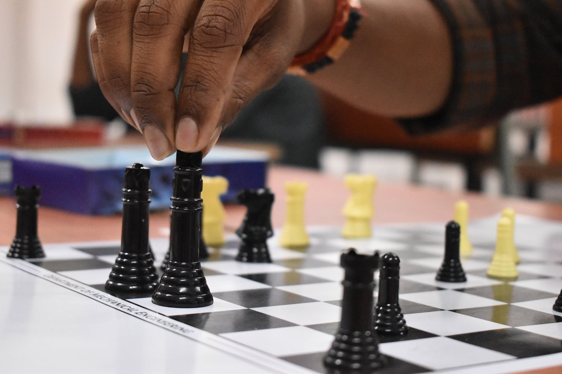 black and yellow chess pieces